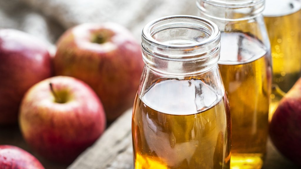 apple and apple cider vinegar bottles filled