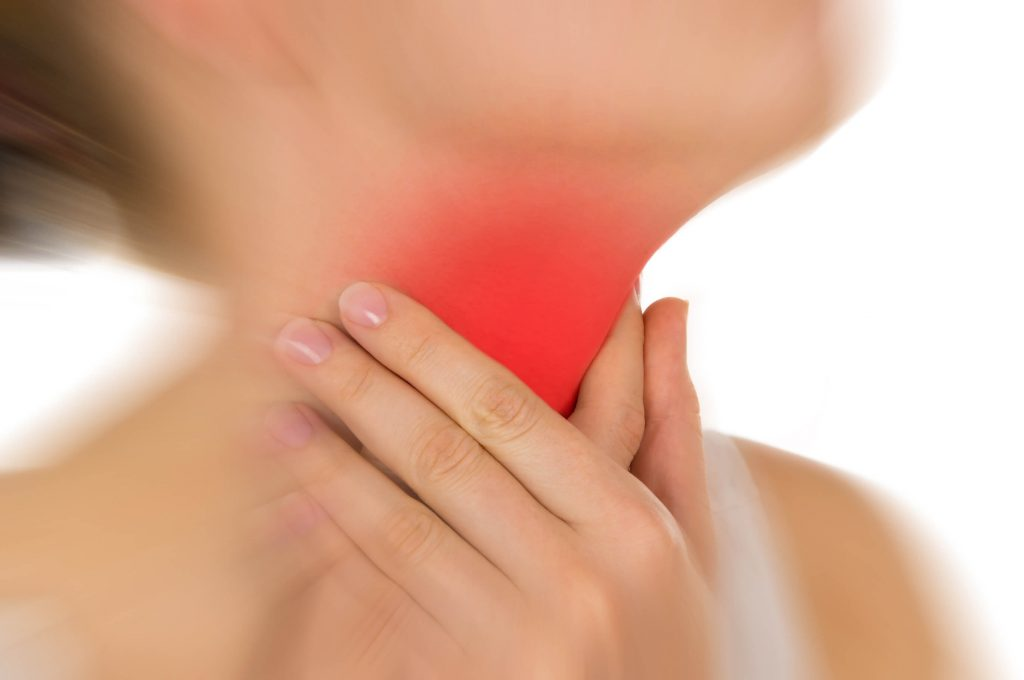 woman experiencing heartburn and burning in the throat